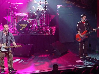 Kim Deal - Deal (right) and Black Francis performing in 2004 Pixies concert.