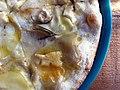 Pizza med kartofler, gedeost og trøffelolie (7580906898).jpg