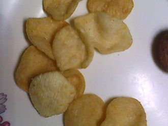 "Potato chip - A Bangladeshi version of potato chips, marketed as ""potato crackers."""