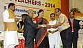 Pranab Mukherjee presenting the National Award for Teachers-2014 to Shri Krishna Kanta Talukdar, Assam, on the occasion of the 'Teachers Day', in New Delhi. The Union Minister for Human Resource Development.jpg
