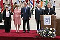 President George W. Bush and Laura Bush are joined by Aliza Olmert and Shimon Peres watch as Ehud Olmert delivers remarks.jpg