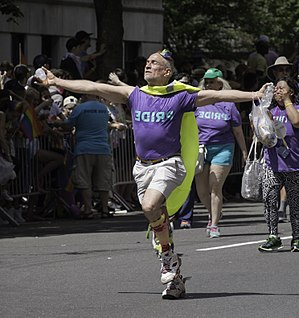 A man in the NYC Pride Parade in 2017