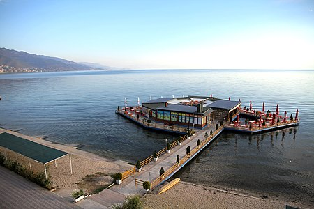 Small restaurant on a platform by the Lake Ohrid shore in the town Pogradec, Albania, September 2018