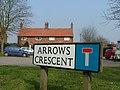 Road sign for Arrows Crescent, adjacent to the Devils Arrows Standing Stones, Boroughbridge.jpg