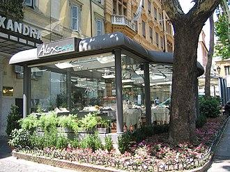 Sidewalk cafe - An enclosed sidewalk cafe on Via Veneto in Rome