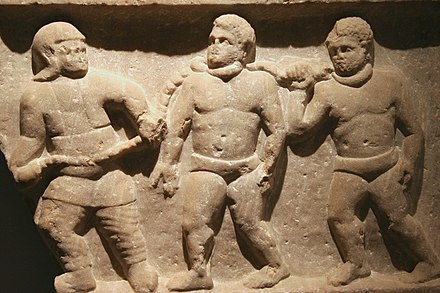 Slaves in chains, at Smyrna (present day Izmir), 200 AD Roman collared slaves - Ashmolean Museum.jpg