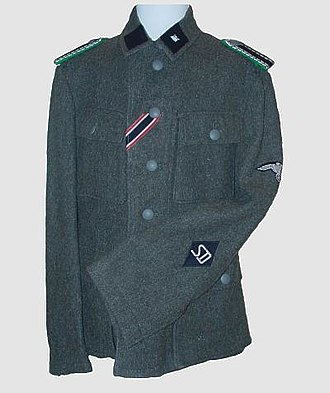 Sicherheitsdienst - Uniform jacket of a SD Unterscharführer of the SS with the typical SD sleeve insignia and the shoulder boards of the Schutzpolizei