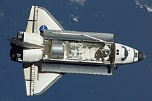 STS-123 Dextre&Kibo ELM-PS in orbit (cropped).jpg