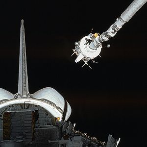 STS-3 - The Plasma Diagnostics Package (PDP) is grappled by the shuttle's Remote Manipulator System.