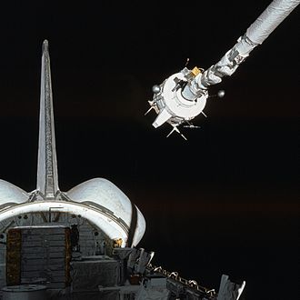 Robotic arm - The SRMS while deploying a payload from the cargo bay of the Space Shuttle