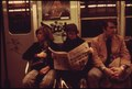 SUBWAY RIDERS LOST IN THEIR OWN THOUGHTS AND READING THE NEWSPAPER ON THE LEXINGTON AVENUE LINE OF THE NEW YORK CITY... - NARA - 556666.tif