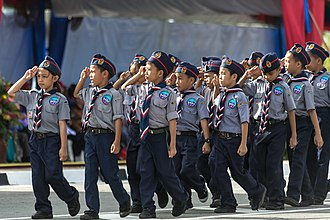 Persekutuan Pengakap Malaysia - A group of Scouts giving Scout sign during the celebrations of Hari Merdeka 2013
