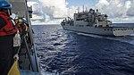 Sailors assigned to USS John P. Murtha (LPD-26) watch as the ship pulls alongside USNS Richard E. Byrd (T-AKE-4).jpg