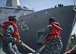 Sailors release the mooring lines as USS Somerset departs for a scheduled deployment. (30370165696).jpg