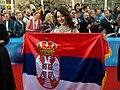 Sanja Vučić with the Serbian flag.jpg