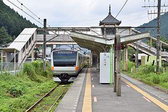 Ōme Line - A JR East E233-0 series train at Sawai Station on the Ome Line.