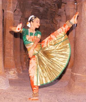 Tandava - Rudra Tandava: A dancer depicting Shiva kicking Yama, the god of Death.