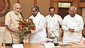 Siddaramaiah calling on the Prime Minister, Shri Narendra Modi, in New Delhi. The Union Minister for Law & Justice, Shri D.V. Sadananda Gowda and the Leader of Opposition in the Lok Sabha.jpg