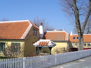 Skagen - Typical Skagen house: red tiled roof with white trimmings, yellow-plastered walls and a white fence