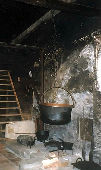 Kitchen - 18th century cooks tended a fire and endured smoke in this Swiss farmhouse smoke kitchen.