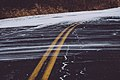 Snow drifting on road - winter in Minnesota (38791630495).jpg