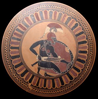C Painter - Inside of a Siana cup: a squatting warrior brandishing a sword; perhaps Achilles awaiting Troilos. ''Circa'' 560 BC. Munich: Staatliche Antikensammlungen