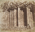Staffa near Fingal's Cave (seated figure who might be John Muir Wood).jpg