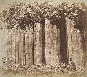 Edinburgh Calotype Club - John Muir Wood, Staffa near Fingal's Cave (with seated figure who might be photographer), c. 1850