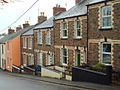 Stepped terraced houses of local stone and two-tone brick, Myrtle Street, Appledore (geograph 4445765).jpg