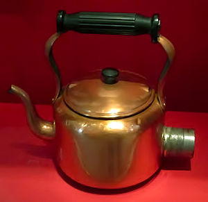 Bulpitt & Sons - A Swan electric kettle in brass, at the Museum of Liverpool, England