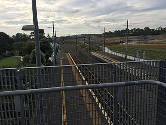 Swanson railway station - A photo of the platforms as well as tracks leading into the station. Photo faces east.