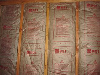 R-value (insulation) - Installed faced fiberglass batt insulation with its R-value visible (R-21)