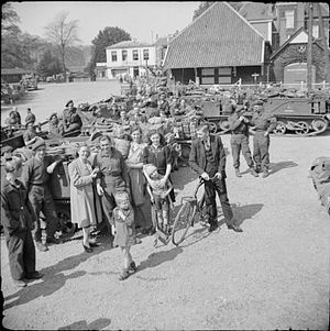 Hallamshire Battalion - Men of the Hallamshire Battalion with civilians, Holland, April 1945.