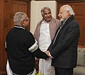The Chief Minister of Kerala, Shri Oommen Chandy and the Leader of Opposition V.S. Achuthanandan calling on the Prime Minister, Shri Narendra Modi, in New Delhi on January 13, 2015.jpg