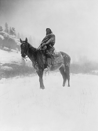 Pryor Mountain Mustang - A Crow scout on horseback in the Pryor Mountains in the early 1900s