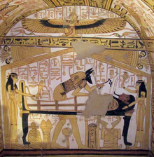 Fresco of a mummy lying on a bier. Women stand at the head and foot of the bier, while in the register above, a woman spreads her arms, to which feathers are attached.