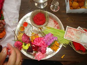 Dashain - The tilaka (in red) and jamara used during Dashain