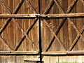 Two barn doors closed with a latch.jpg