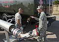 U.S. Air Force Master Sgt. Edward Braddy, right, an instructor with the 364th Training Squadron, instructs Airman Kyle Coates, left, on how to connect a single point nozzle to an R-11 jet fuel truck during 110712-F-NS900-009.jpg