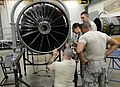 U.S. Air Force Staff Sgt. Lloyd Jarell, Airman 1st Class Carissa Barrera, Airman 1st Class Bruce Smith and Airman 1st Class Brenton Repine, all assigned to the 372nd Training Squadron, work on an F-16 Fighting 130522-F-CX352-026.jpg
