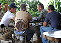 U.S. Army Gen. P.K. Keen, commanding general of Joint Task Force Haiti, talks with actor Sean Penn March 15, 2010, in Port-au-Prince, Haiti 100315-N-HX866-007.jpg