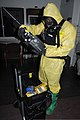 U.S. Army Sgt. 1st Class Alphonso Meriweather, a chemical, biological, radiological and nuclear specialist with the 52nd Civil Support Team, checks detection equipment at the Muscatatuck Urban Training Complex 120727-A-WW110-085.jpg