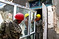 U.S. Army Sgt. Phil E. Chavez, right, with the 176th Engineer Company, 96th Troop Command, Washington Army National Guard, helps Mongolian Armed Forces engineers with the 017 Construction Regiment as they work 130725-M-MG222-005.jpg