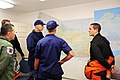 U.S. Coast Guard Vice Adm. Paul F. Zukunft, the Coast Guard Pacific Area commander, and Rear Adm. Thomas P. Ostebo, the Coast Guard 17th District commander, receive an area overview and debriefing from Lt. Cmdr 120724-G-ZP298-007.jpg