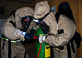 U.S. Marine Corps Lance Cpl. Barkley, right, and another troop plug a leaking tank cylinder while in chemical suits during joint chemical warfare training at Camp Buehring, Kuwait, Sept 090903-A-PT935-135.jpg