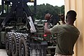 U.S. Marine Corps Pfc. Perren Alexander with Combat Logistics Battalion 8, Transportation Support Company, guides a Logistics Vehicle System Replacement on Naval Weapons Station Norfolk-Cheatham Annex, VA 120612-M-KS710-031.jpg