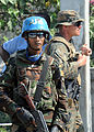 U.S. Marines and United Nations peacekeepers from Sri Lanka provide security at a food distribution point in Carrefour, Haiti 100216-N-HX866-013.jpg
