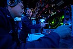 U.S. Navy Operations Specialists 3rd Class Andrew Jones, left, and Taylor Melendez scan for surface contacts June 29, 2013, in the combat information center aboard the amphibious dock landing ship USS Pearl 130629-N-WD757-017.jpg