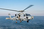 U.S. Navy sailors aboard USS STOCKDALE (DDG 106) conduct a helicopter in-flight refueling drill with an MH-60R Sea Hawk on the ship's flight deck in the Persian Gulf.jpg