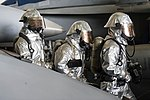 U.S. Sailors dressed in proximity suits simulate a hot spot search with a naval firefighting thermal imager during a general quarters drill in the hangar bay of the aircraft carrier USS Harry S. Truman (CVN 75) 140308-N-ZG705-555.jpg